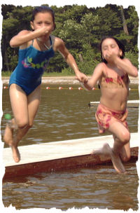 Two Girls Jumping in Water photo courtesy of Jack Porcello